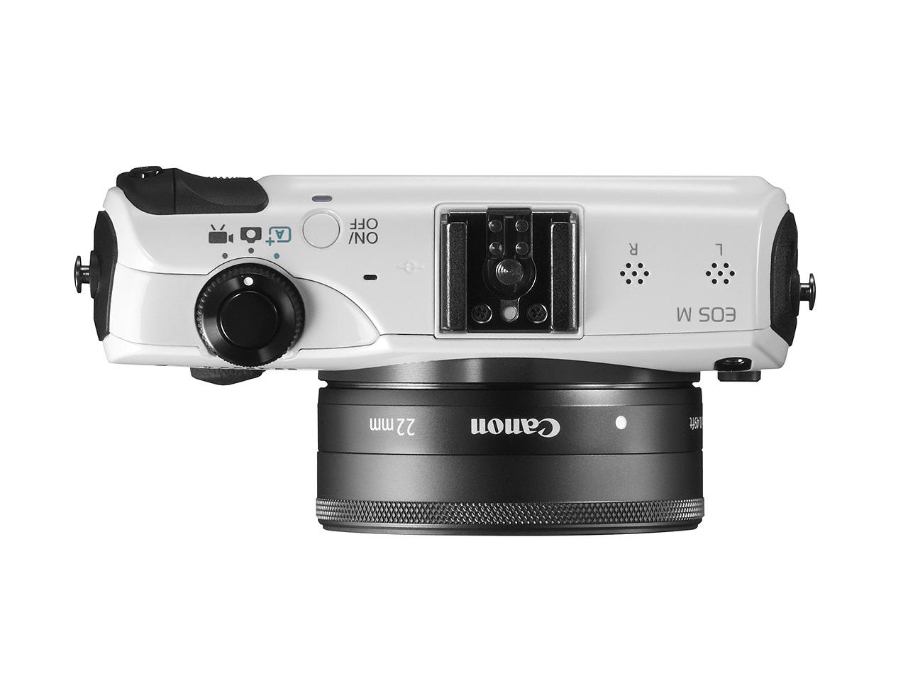 Canon EOS-M ด้านบน แสดงให้เห็น Hot-shoe ที่เอาไว้ต่อแฟลชภายนอกและปุ่มหมุนควบคุมหลัก